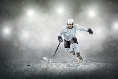 Ice hockey player on the ice, outdoors Stock Photo - 48722913
