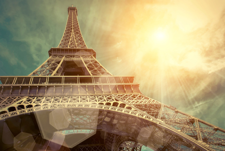 symbol tourism: The Eiffel tower is one of the most recognizable landmarks in the world under sun light