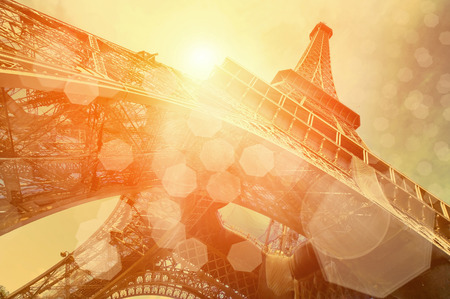 french culture: The Eiffel tower is one of the most recognizable landmarks in the world under sun light
