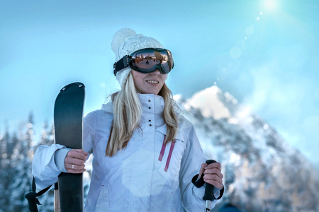 stay beautiful: Female at ski stay on the top of mountain with beautiful view Stock Photo