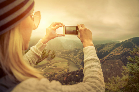 people travelling: Young woman selfie on the beautiful nature view in mountains. Stock Photo