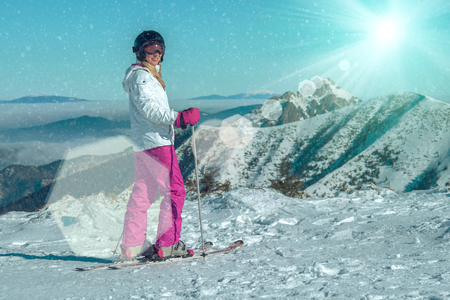 stay beautiful: Happiness female at ski stay on the beautiful mountains view Stock Photo
