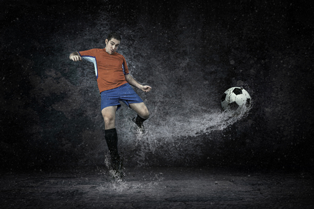 emulation: Splash of drops around football player under water Stock Photo