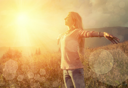 nature of sunlight: Happiness woman stay outdoor under sunlight of sunset Stock Photo