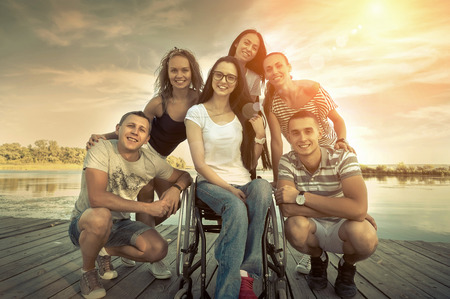happines: Happines group of Friedns on the wooden pier. Stock Photo