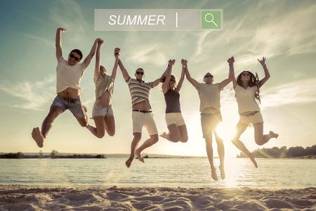Friends jumping on the beach under sunset sunlight.
