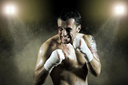 man power: Portrait of boxer in blood