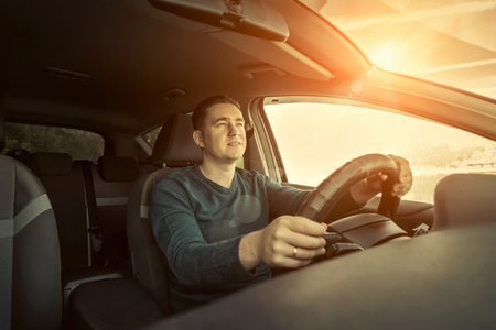 man driving: Man sitting and driving in the car