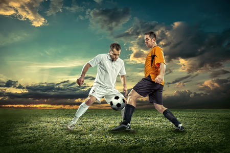 soccer player: Soccer player with ball in action outdoors. Stock Photo