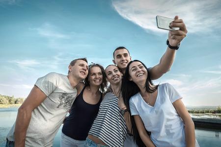 20 29 years: Selfie of grop happiness friends under sunlight.