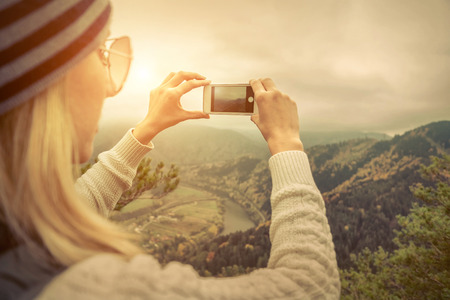 20 29: Young woman selfie on the beautiful nature view in mountains. Stock Photo