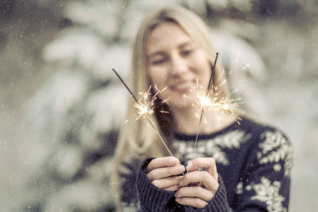 20 29 years: woman with sparkler at winter.