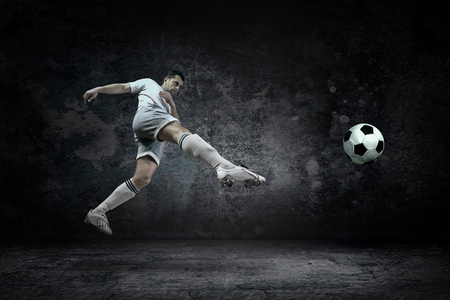 waterpool: Splash of drops around football player under water Stock Photo