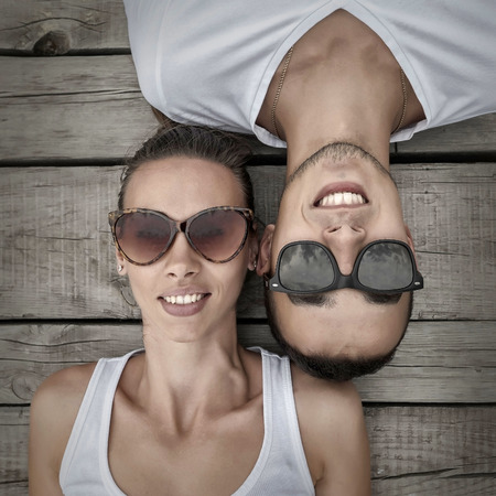 20 29: Portrait of couple on the wooden background.