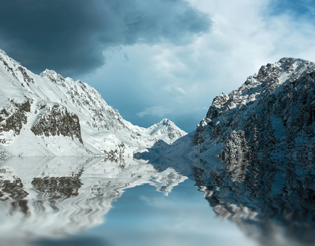 reflex: Beautiful mountains view with reflex at winter under sky. Stock Photo