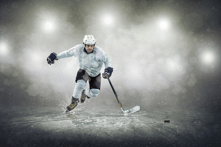 hockey skates: Ice hockey player on the ice, outdoors