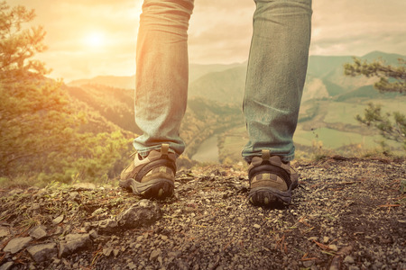 stay beautiful: Men stay in Mountains footwear on the beautiful view.