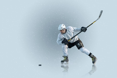 hockey skates: Ice hockey player on the ice and light effects