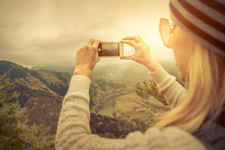 20 29 years: Young woman selfie on the beautiful nature view in mountains. Stock Photo