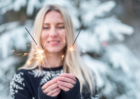 20 29: woman with sparkler at winter.