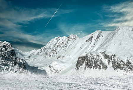 wintery day: Beautiful mountains view at winter under sky.