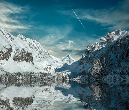 wintery day: Beautiful mountains view with reflex at winter under sky. Stock Photo