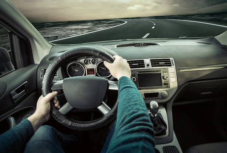 driving a car: Man sitting and driving in the car. Stock Photo