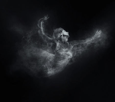 black smoke: Dancer from smoke on the dark background