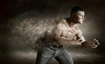 Bodybuilder drops splashing on thegrunge background photo