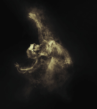 abstract dance: Dancer from smoke on the dark background