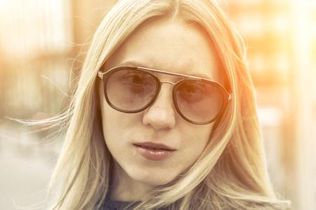 joyfull: Portrait of blonde female on the street.