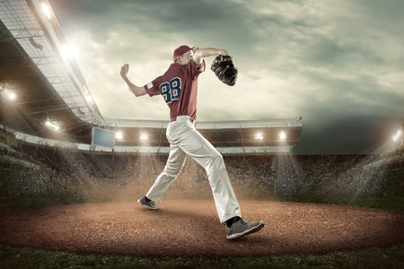 baseball pitcher: Baseball players in action on the stadium.