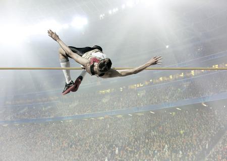 Atleta in azione di salto in alto. Archivio Fotografico - 60084480