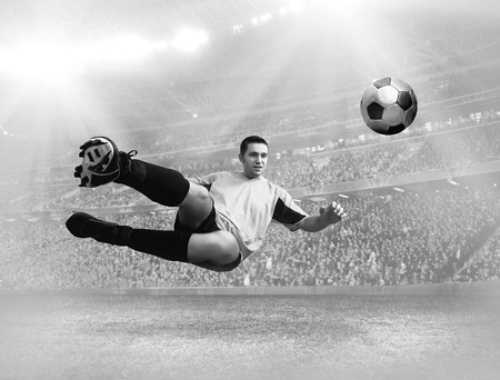 arquero de futbol: Soccer player with ball in action on field of stadium