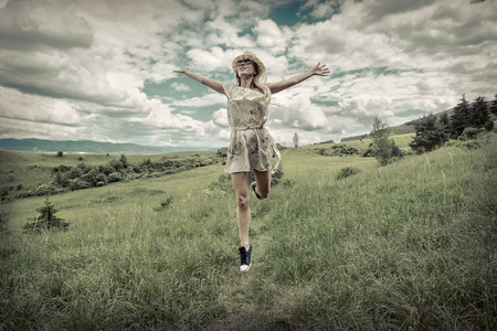 vitality: Happiness Female in hat on the green meadow at sunny day in summertime. Stock Photo