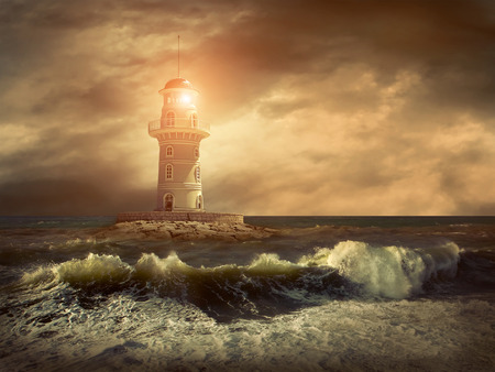 lighthouse at night: Lighthouse on the sea under sky.