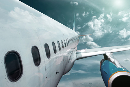 aerodynamic: Airplane at fly on the sky with clouds Stock Photo