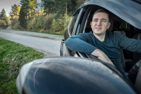 Man sitting and driving in the car. Stock Photo