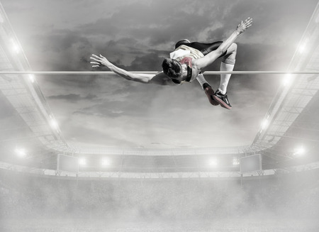 high jump: Athlete in action of high jump.