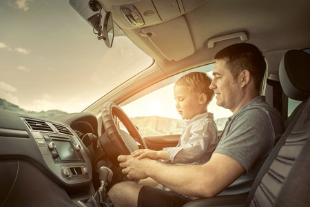 father and son: Father and son driving in car Stock Photo