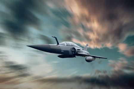 Military airplan on the speed in the sky