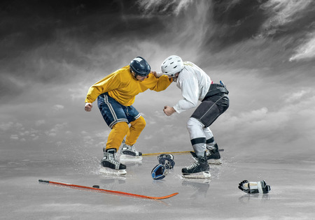 sportsmanship: Ice hockey player in action on the ice outdoor under sky