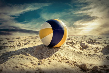 blue ball: Beach Volleyball. Game ball under sunlight and blue sky.