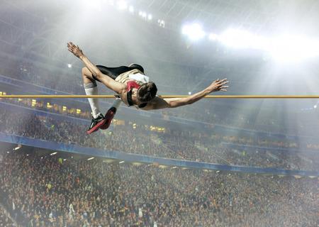 Atleta en la acción de salto de altura. Foto de archivo - 65427110
