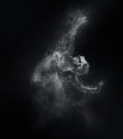 Dancer from smoke on the dark background