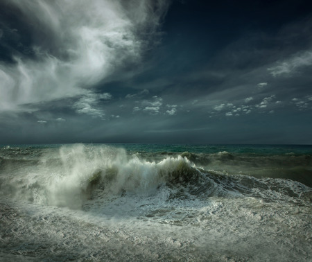 strong wind: View of great storm on the sea. Strong wind and big waves with splash drops under dark sky.