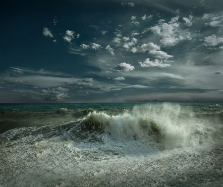 mistic: View of great storm on the sea. Strong wind and big waves with splash drops under dark sky.