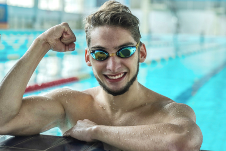 waterpool: Swimmer man. Portrait of swimming athlete with goggles after training in waterpool. Stock Photo