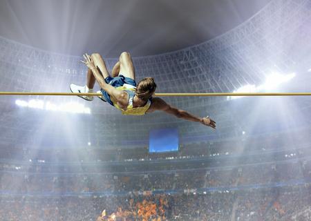 sportsmen: Athlete in action of high jump.