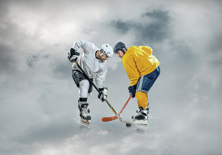 padding: Ice hockey players in box sport action on the ice outdoor under sky.